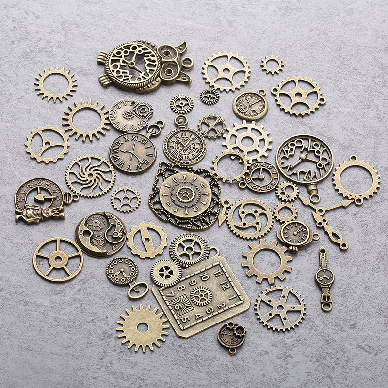 Vintage metal cogs gears and clock designs from AliExpress for mixed media art