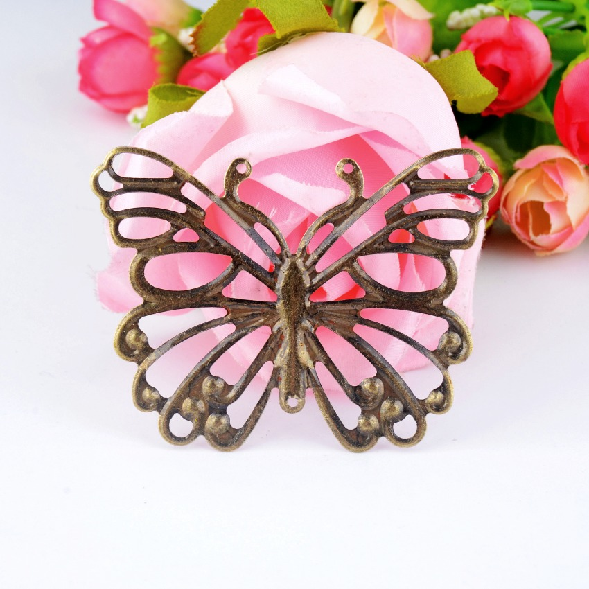 Butterfly metal embellishment from AliExpress for mixed media art projects, where to buy mixed media art supplies, mixed media embellishments from AliExpress